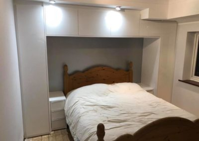 Wardrobe built around bed frame | The Sliding Wardrobe Company | Kent | Essex | East Sussex