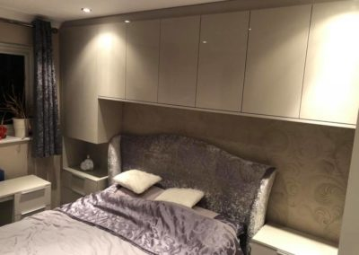 Cupboards and side table built in around bed frame | The Sliding Wardrobe Company | Kent | Essex | East Sussex