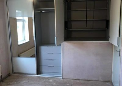 Built in wardrobe in bedroom with mirror | The Sliding Wardrobe Company | Kent | Essex | East Sussex